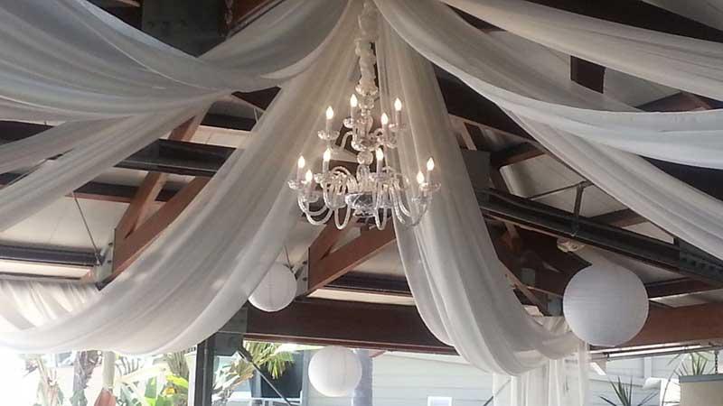 Bali Hai Wedding Lighting Ceiling Draping and Chandelier