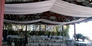 Bali Hai Ceiling Draping with Market Lights for San Diego Wedding