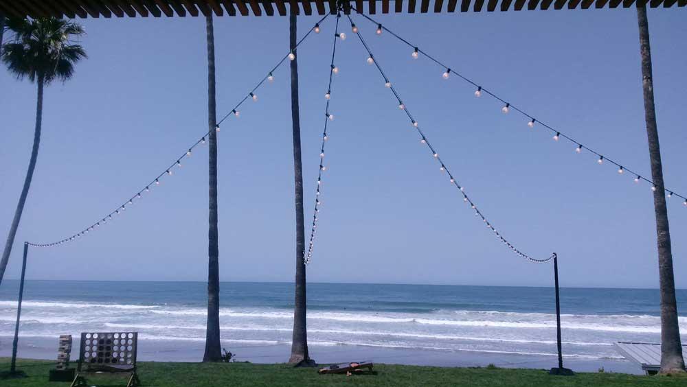 Backdrop with ceiling drapes market lights Scripps Seaside Forum